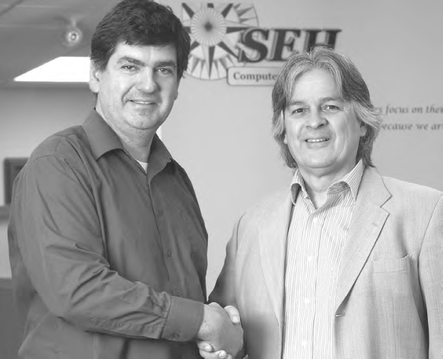 Allan Griwatz (left) with SEH Computer Systems Inc. President Kevin Remington. (Bill Gladding / Tavistock Gazette)